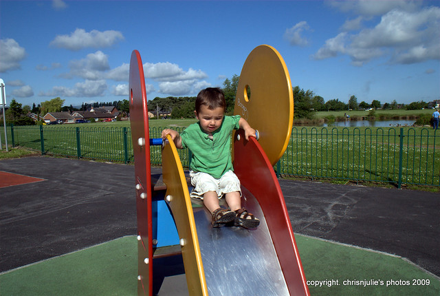 on the slide in the park