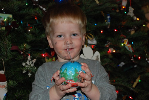 Nikolas and his favorite ornament | by Kathy Schwartz