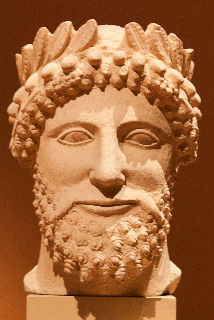 Limestone head of a bearded man wearing a wreath. Cypriot, early 5th Century BC  The Metropolitan Museum allows photo shooting providing there is no financial gain.  Please respect their policy