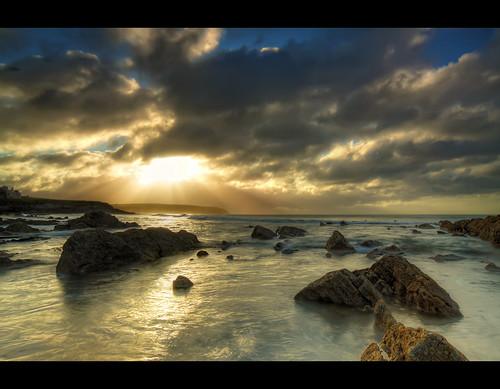 ocean morning ireland light sea seascape clouds sunrise landscape dawn rocks waves waterford clonea lightrays dungarvan cloneastrand