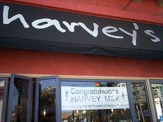Sign on Harvey's congratulating Harvey Milk for winning Medal of Freedom