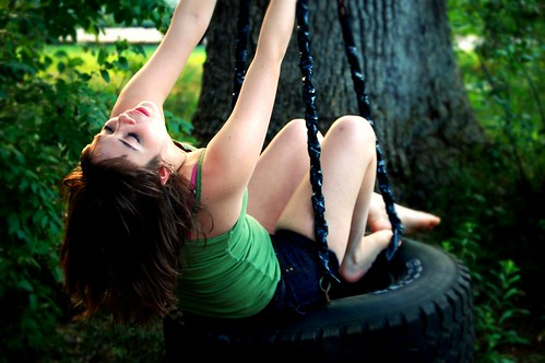 light sunset summer people sun tree girl leaves hair outside person kid nikon focus arms legs tire swing tireswing teenager tori devendra d40 nikond40