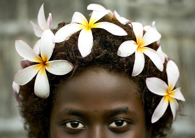 Bougainville girl and frangipan headress - Papua New Guinea