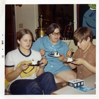 My late sister Lisa Jo Lane, late mom Dee Lane, brother Ward Lane, eating a flaming cake for Christmas / New Years in Anchorage, Alaska with mom's award winning Russian samovar in the background, December 1971