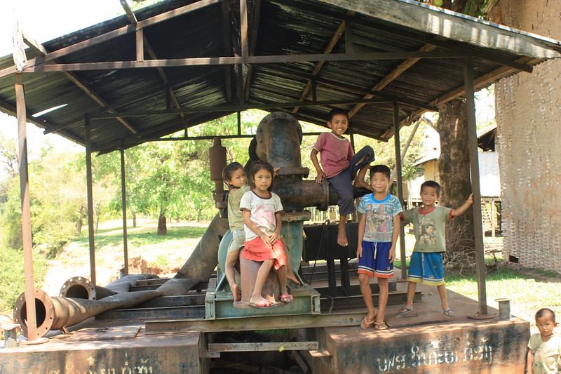 Children play on disused irrigation pump