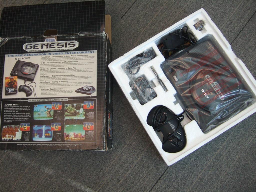 Sega Genesis - original packaging, hot   SEGA of America