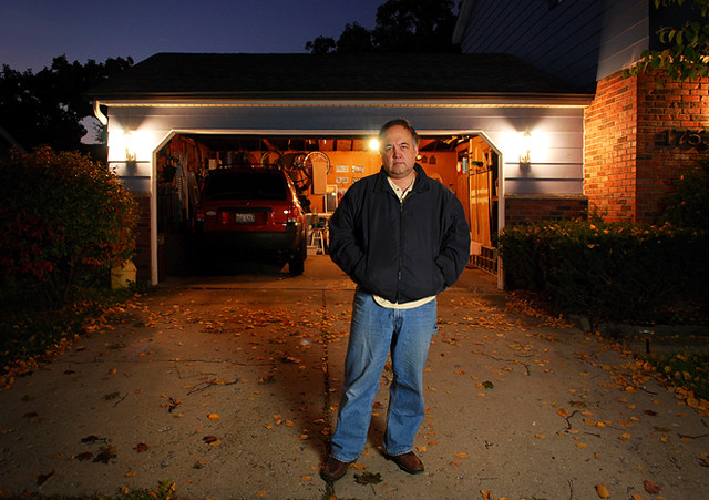 Self portrait with garage and driveway