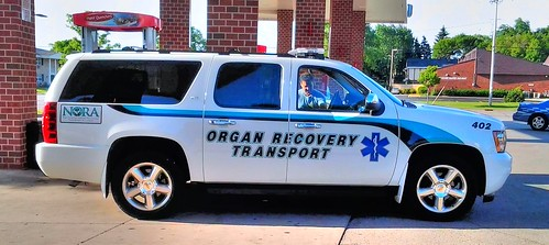 Greendale Wisconsin, 7-19-2015. Chevrolet Suburban as a Organ Recovery Transport Squad. 83 degrees outside. Photo