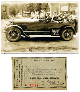 Tourists in a 1923 Cadillac at Glen Cove on Pikes Peak in Colorado and souvenir ticket, June 26, 1928