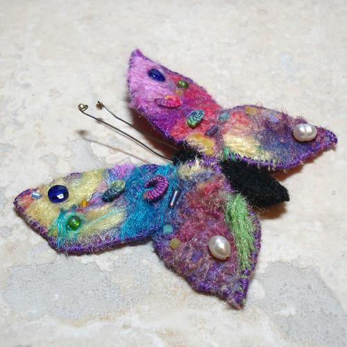 Rainbow butterfly   by tastykaeru