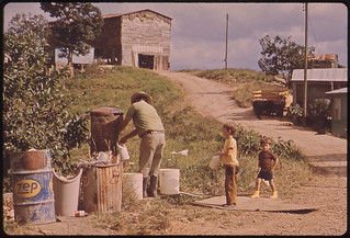 Father and Sons Fill Their Containers at the Community Water Pump. This Is a Mountain Farming Area 02/1973