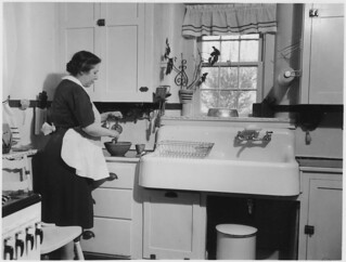 Woman Cooking in a Kitchen. | by The U.S. National Archives