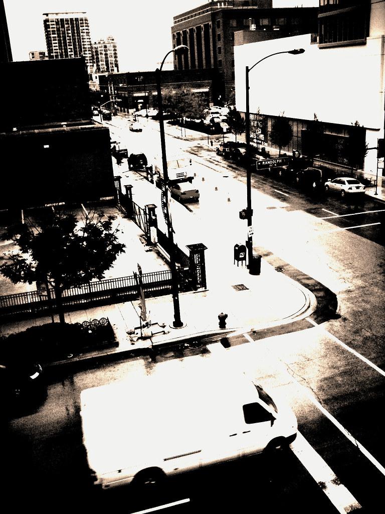 Street corner in the rain by swanksalot