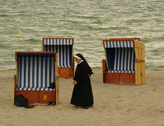 alone nun on the beach | by Petrusia1