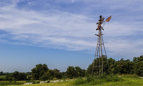 abandoned oklahoma broken windmill field clouds landscape outdoor pasture rusted hay