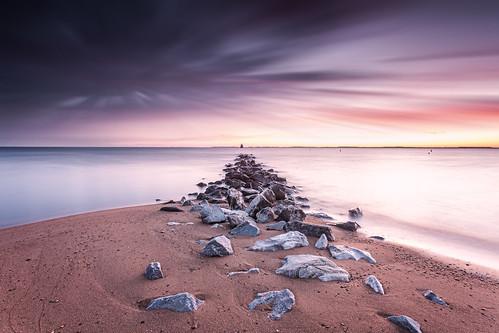 sandypoint shoallighthouse jetty beach boulders waterscape chesapeakebay clouds landscape leefilters longexposure maryland neutraldensity skidmore luminosity fauxle sliderssunday