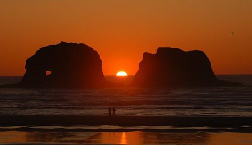 ocean sunset sun water silhouette rock stone oregon waves pacific rockawaybeach twinrocks