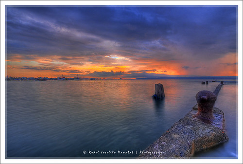 ocean longexposure trip travel blue light sea vacation sky sun seascape color colour reflection art beach nature beautiful beauty smile clouds contrast photoshop sunrise canon landscape geotagged photography photo rocks exposure dof photos philippines wharf pk canoneos hdr highdynamicrange davao hdri blending waterscape rodel sigma1020mm mabuhay photomatix kadayawan tonemap colorphotoaward impressedbeauty aplusphoto pinoykodakero canon40d colourartaward perfectescapes rodelicious ifolio garbongbisaya rodeljoselitomanabat gettyimagesphilippinesq1 gettyimagesasia gettyimagesphilippines