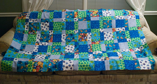 Quilt top: sewn. Time to buy the batting, iron the backing, then get this puppy pinned together, quilted, bound, and given away.