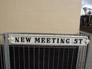 New Meeting St road sign - Site of New Meeting House where Joseph Priestley was minister - Saint Michaels Catholic Church