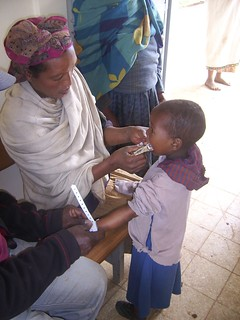 Ethiopia-Checking body mass of malnourished child | by fish030