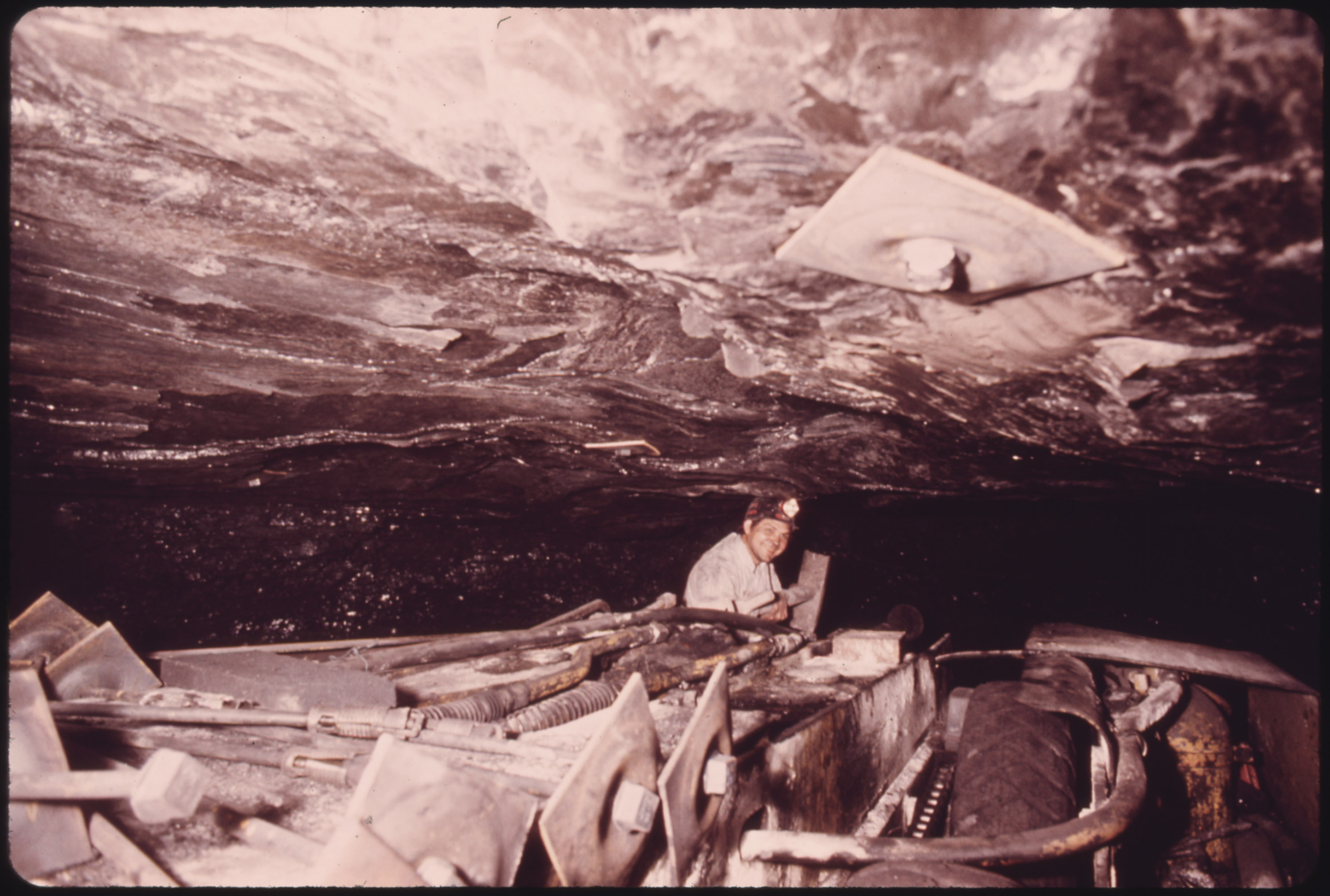 Miner Lee Caldwell, on a Self-Propelled Roof Bolting Machine in a Mine of the Tennessee Consolidated Coal Company near Jasper and Chattanooga 08/1974