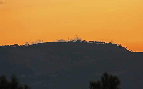 samossunrise2009 sunrise dawn beautiful greekisland greece nature mountainridge ridge trees clouds wispy wispyclouds orange canon450d ef70300mmf456is silhouette
