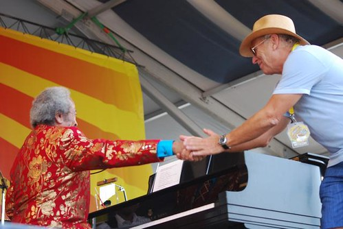 Allen Toussaint and Jimmy Buffet share a handshake at Jazz Fest 2011