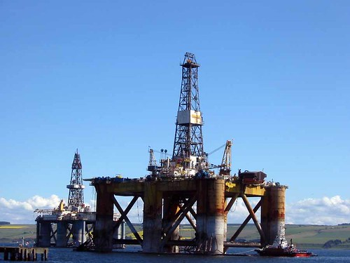 Tugs moving an oil rig near in Invergorden   by Guy R