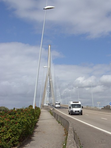 Pont de Normandie, Claire had to hop off to take it as I held the bike up on gravel. We were still alive.