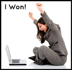 successful business woman on a laptop | by Search Engine People Blog