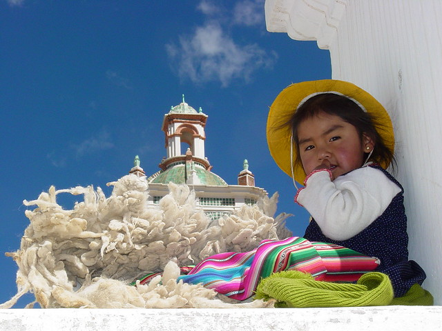 Young Girl with Wool in Niche of Cathedral Wall - Copacabana - Bolivia