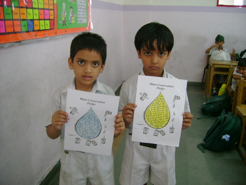 Children showing their water pledges