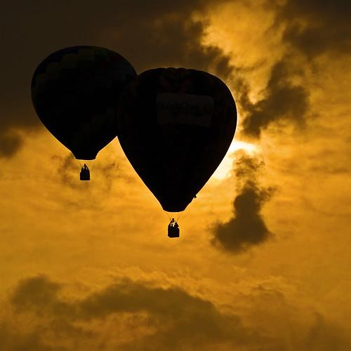 sunset orange usa sun night clouds balloons newjersey glow sony crowd balloon nj silhouettes f100 darthvader shape frontpage f250 readington solbergairport njfestivalofballooning v1000 newjerseyfestivalofballooning a900 festivalofballooning alpha900 sonyalpha900 anadelmann