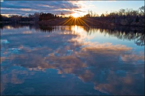 lake reflection sunrise sunburst loafers