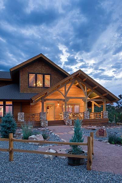 Distinct Western Elegance - Timber Frame Home Back View