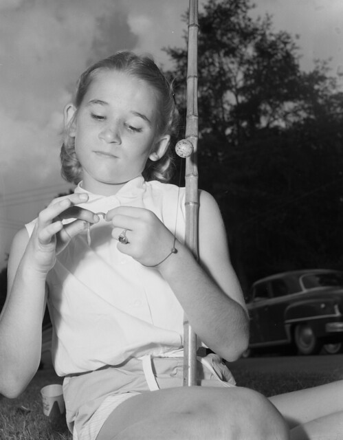 Girl baiting hook during Tallahassee Fishathon