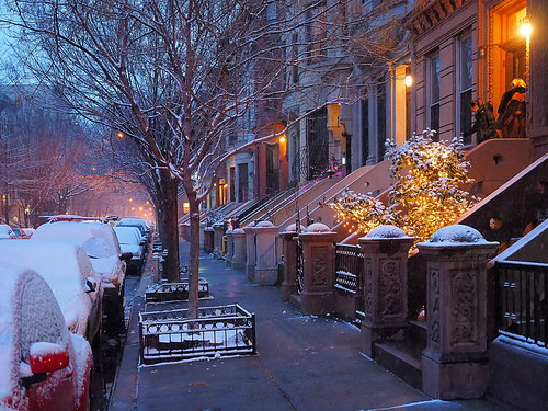 harlem newyork brownstones snow streetscape houses steps peaceful beautiful lights cars urban night street people winter trees