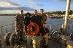 Royal Australian Navy Lt. Cmdr. Alison Zilko, left, civilian mariners Shannon Alves, Fred Beck, Daniel Claycomb and Australian Army Lt. Col. Rod Petersen all participated in saving a local man's life after he had fallen off a boat at Honiara July 10.  (U.S. Marine Corps/Sgt. James Gulliver)