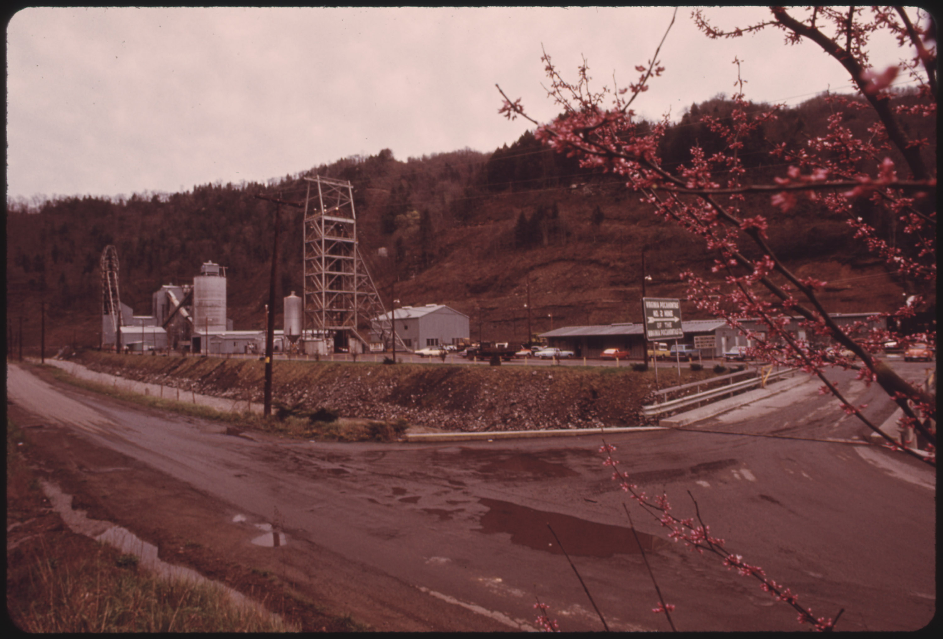 Picture of Virginia-Pocahontas Mine #2 near Richlands Virginia, in a Picturesque Setting with a Red Bud Tree in the Foreground 04/1974