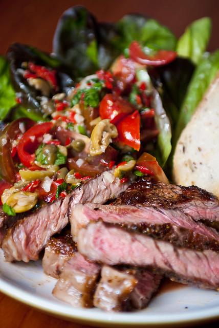 Rib eye steak with tomato-caper relish