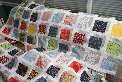 It's funny; this risqué little quilt actually looks pretty normal from a distance.  I love that my beloved frog shorts got a second life in this quilt. Then there's the brassiere fabric ... and the sex-positions fabric ... and the love-letters fabric ... I think at least half of the fabrics in this quilt are dirty jokes.  I am totally okay with this.  Remember: it's a cheat sheet that keeps you warm!