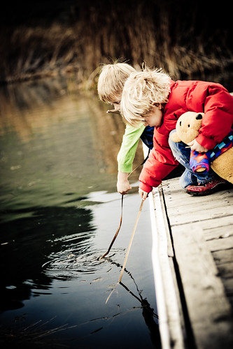 Children playing on a dock | by tibchris