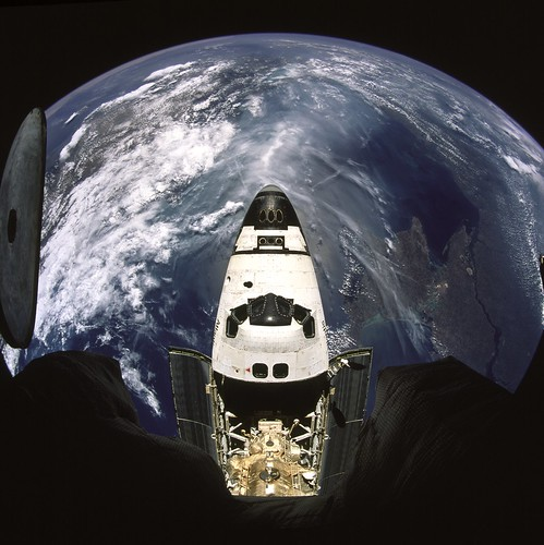 Earth and Space Shuttle Atlantis
