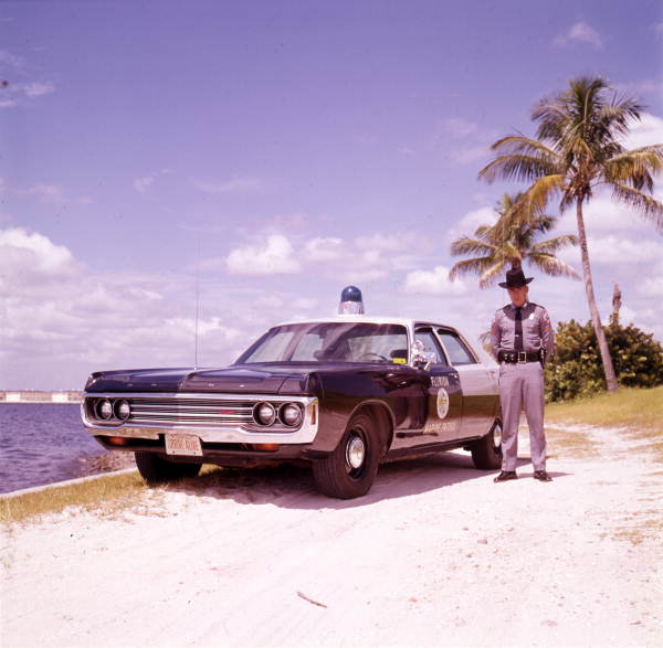 Florida Marine Patrol officer with his vehicle