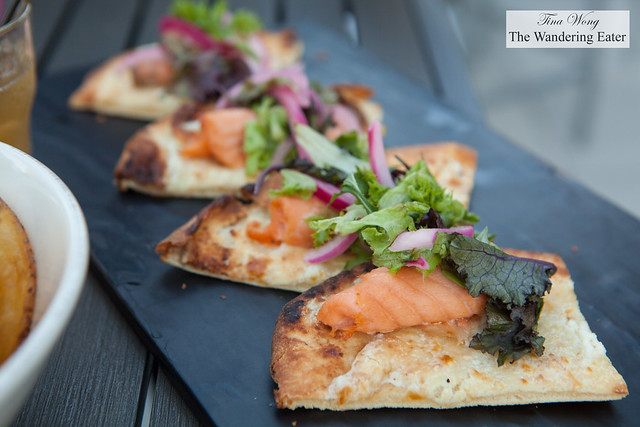 Baked salmon flatbread with pickled onions