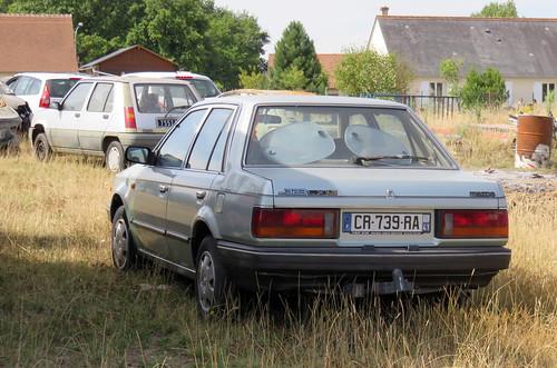 Mazda 323 LX 1.3 saloon   by Spottedlaurel