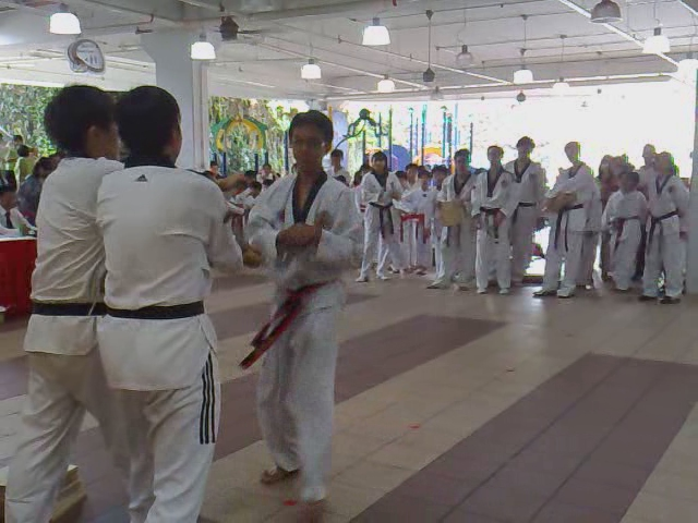 Farid takes taekwondo exam for black belt