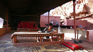 catching up on my travel journal in a bedouin tent, wadi rum | by hopemeng