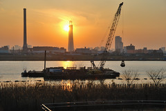 Tokyo Sky Tree and Grab Dredger under Setting Sun
